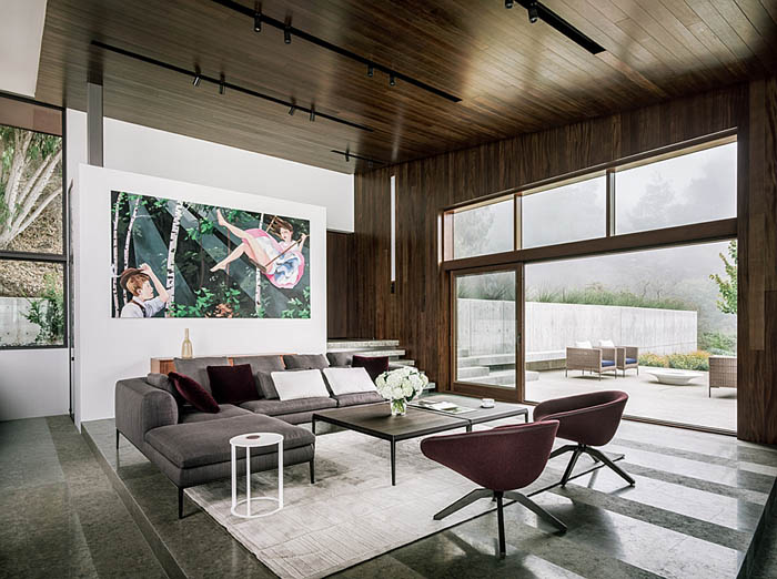 Living-space-with-plush-decor-and-wooden-panelling