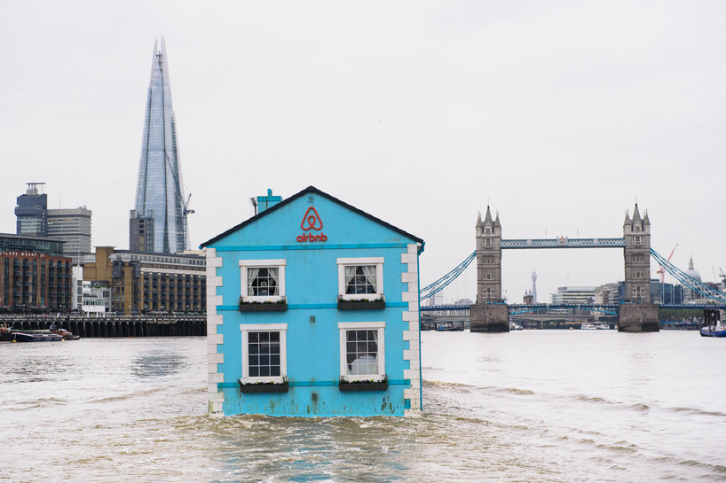 Small House With A Yard Doghouse Floats Down The Thames River