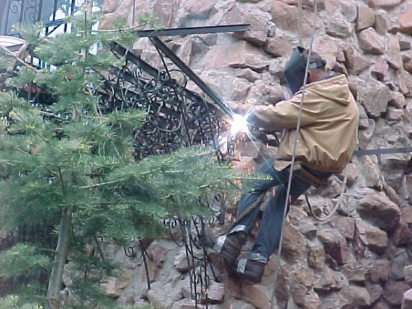 Jim Bishop at work on the iron work of his castle.