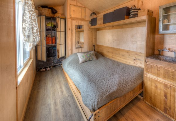 Fall into this full-size Murphy bed at the end of a long day of fishing and blazing the trail.