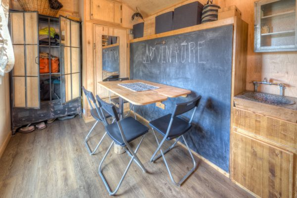 The dining area's chalkboard wall would be excellent for planning a day's surveying of the lands over breakfast.