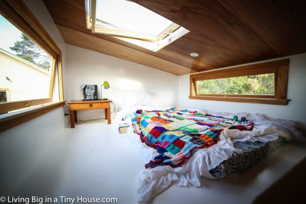 The cavernous bedroom loft with a skylight for stargazing and access to the various systems on the roof.