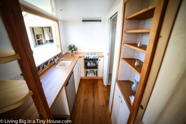 The kitchen is fully featured, with kauri bench tops, a hand crafted ceramic sink, gas stove-oven, and a 130 liter solar fridge. All available spaces haven been transformed to offer ample storage.