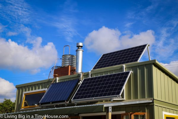 The roof hosts a 600-watt solar panel and rainwater collection system, contributing to the home's sustainability.